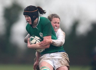 Marie Louise Reilly is tackled by England's Amber Reed.