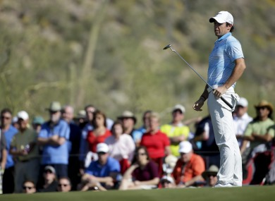 Rory McIlroy reacts to his putt on the 17th hole in his match against Harris English.