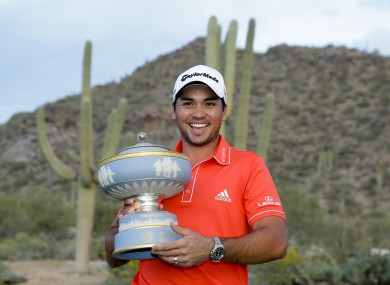 Jason Day, of Australia, poses with the trophy after winning his championship match against Victor Dubuisson.