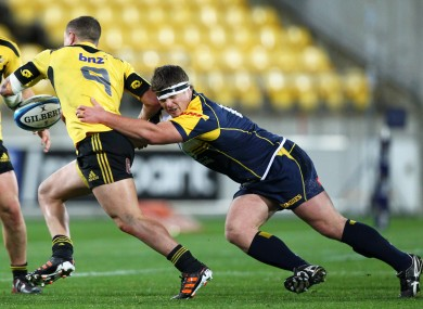 Murphy tackles TJ Perenara of the Hurricanes in 2012.