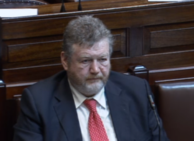 James Reilly listening to debate on his sunbed legislation in the Dáil this morning