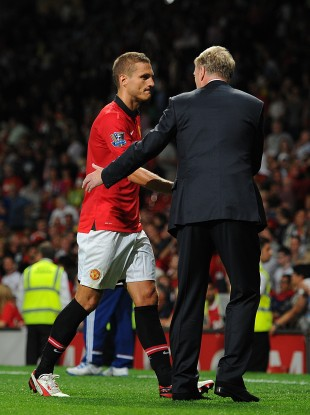 David Moyes shakes hands with his captain Nemanja Vidic.