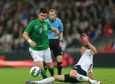 Shane Long is tackled by Michael Carrick when the teams met last May.