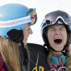 Women's snowboard parallel slalom silver medalist Anke Karstens of Germany, left, and bronze medalist Amelie Kober of Germany celebrate at the Rosa Khutor Extreme Park in Krasnaya Polyana, Russia. <span class=