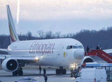 Passengers being evacuated from the hijacked Ethiopian Airlines plane.