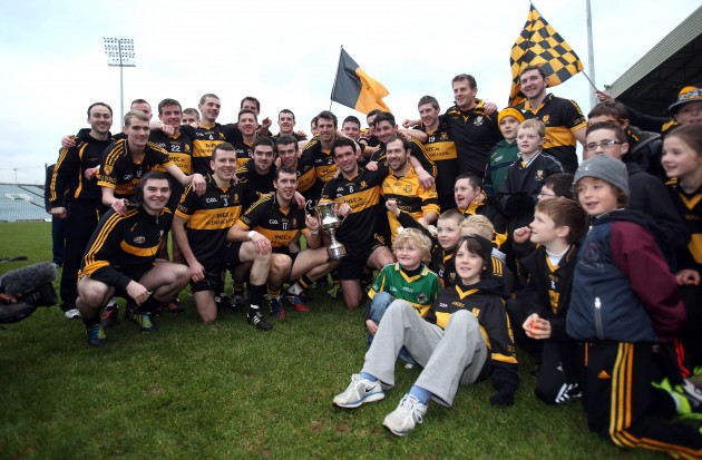 The Crokes team celebrate with supporters after the game