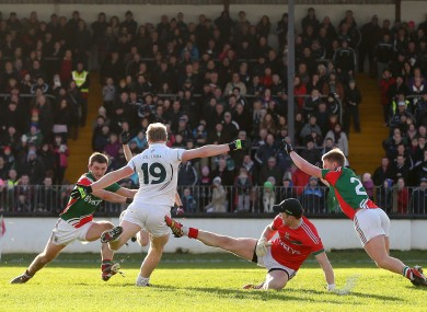 Tomas O'Connor fires the game's opening goal past Rob Hennelly.
