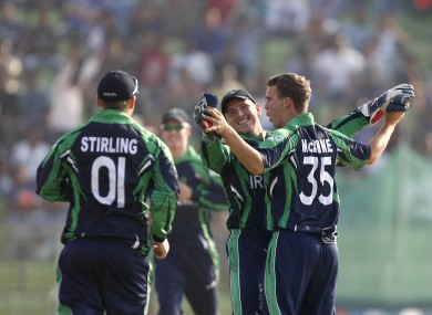 Ireland's Andy Mcbrine celebrates with Paul Stirling and William Porterfield.