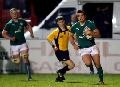 Cian Kelleher runs in Ireland's opening try.