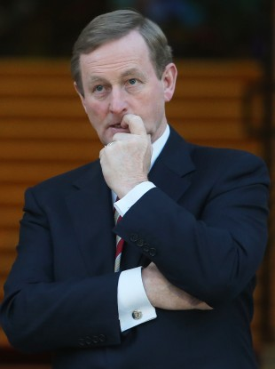 Taoiseach Enda Kenny waiting to meet Bill Clinton outside Government Buildings yesterday evening