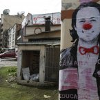 An election poster of Liberal Party legislative candidate Daniel Quintero, defaced with a red nose and bow tie to resemble a clown, covers a wall in Bogota, Colombia. <span class=