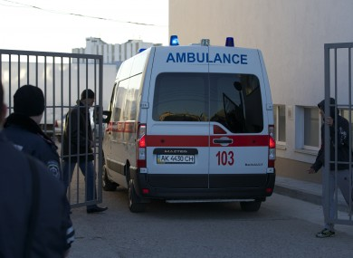 An ambulance enters a territory close to an Ukrainian military unit in Simferopol