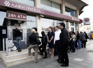 The agreement aims to avoid scenes like this outside a closed bank in Cyprus.