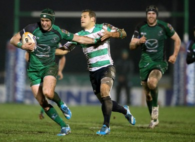 Dave McSharry shrugs off Tobias Botes of Treviso.