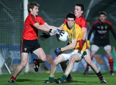 Meath's Donncha Tobin with Conor Maginn and Conor Garvey of Down.