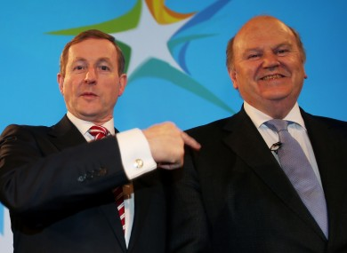 Fine Gael leader Enda Kenny with his predecessor Michael Noonan at the RDS today