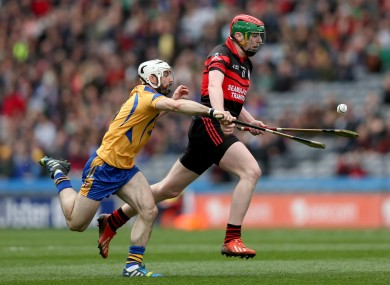 Portumna's Leo Smith with Edward Byrne of Mount Leinster.
