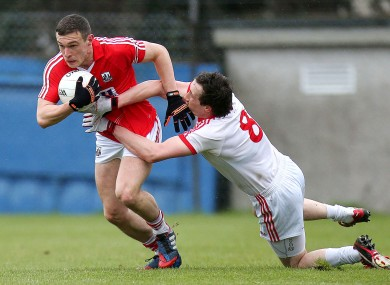 Cork's John O'Rourke and Tyrone's Colm Cavanagh.