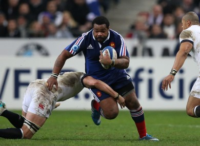 Mathieu Bastareaud is inconvenienced on a romp up the pitch.