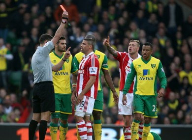 Walters is shown a red card on Saturday.