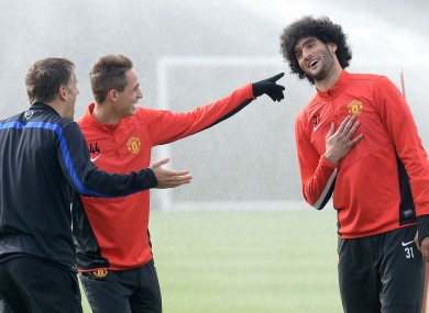 Adnan Januzaj (centre) and Phil Neville laugh at Marouane Fellaini's hair. Presumably.