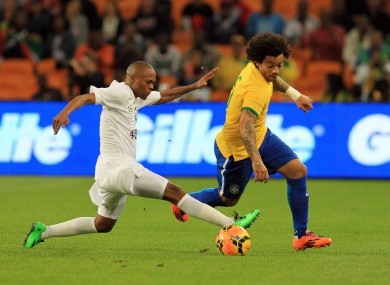 South Africa's Thulani Serero, left, challenges Brazil's Marcelo Vieira, right.