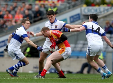Tom Cunniffe of Castlebar surrounded by Tomas Quinn, Diarmuid Connolly and Ciaran Dorney of Vincent's.