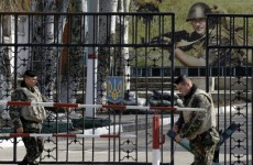 Russian troops and planes flow into Crimea as EU says sanctions are on the table