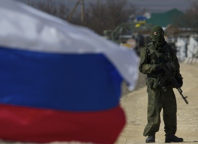 Pro-Russian soldiers block the Ukrainian naval base in the village of Novoozerne