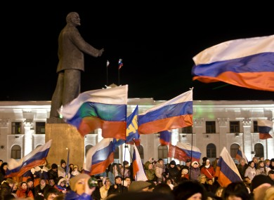 Pro-Russian people celebrate referendum vote in Lenin Square in Simferopol, Ukraine.