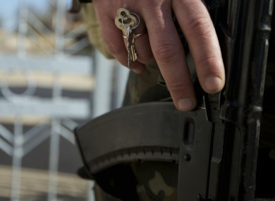 Keys are hooked in a ring of a Ukrainian soldier guarding the naval base headquarters in the town of Novo-Ozerne, some 90 km west of the Crimean capital Simferopol, Ukraine