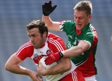 Derry's Emmet McGuckin and Kevin Keane of Mayo playing last weekend.