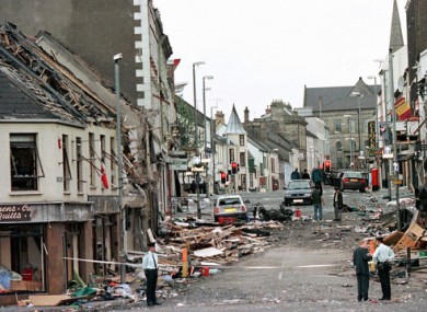 Police officers stand on Market Street, the scene of a car bombing, in the centre of Omagh.