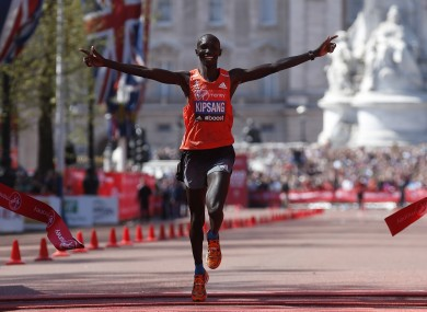 Wilson Kipsang celebrates as he crosses the line.