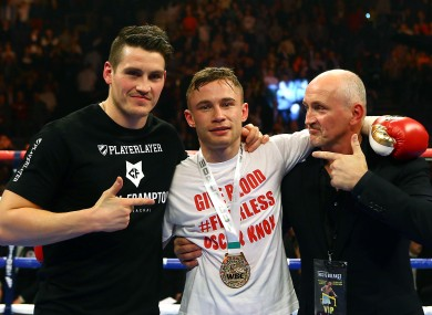 Frampton celebrates last night with trainer Shane McGuigan, left, and manager Barry McGuigan.