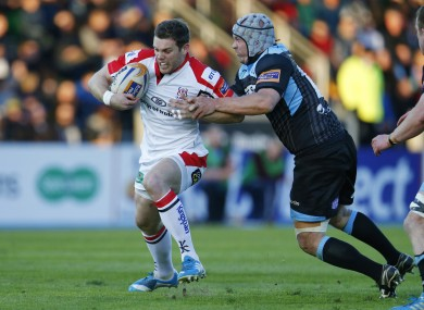 Darren Cave attempts to create an opening for Ulster.