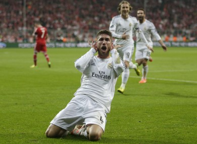Real's Sergio Ramos celebrates scoring his side's second goal.