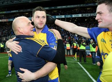 Roscommon coach John Evans celebrates with Donie Shine.