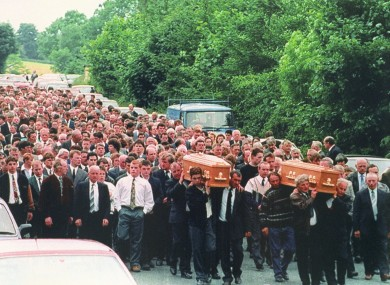 The townspeople of Loughinisland carry the coffins of 87-year-old Barney Green and his nephew Dan McCreanor -- two victims of the tragedy.