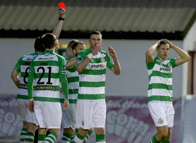 Luke Byrne of Shamrock Rovers is shown a red card.