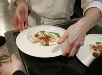 Chef Grant Achatz works in the Alinea restaurant kitchen in Chicago, named the best restaurant in the world.