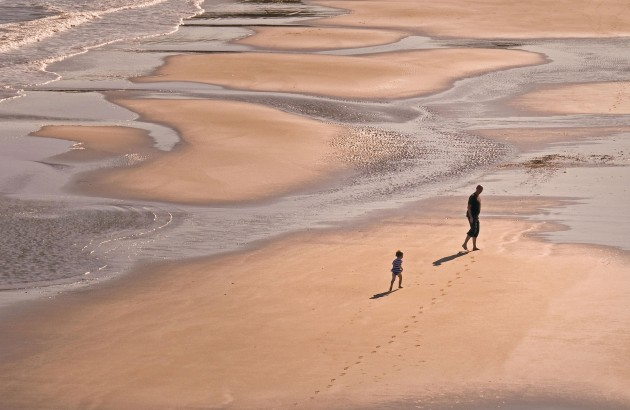 p80-81 Father and son on beach