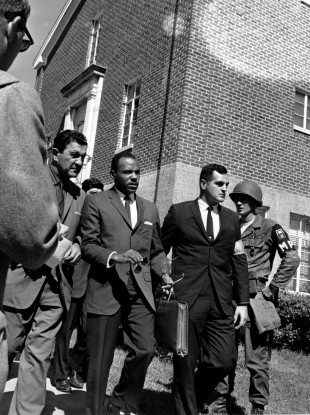 James Meredith is escorted to the University of Mississippi in 1962 as the first black student to attend.