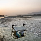 A makeshift chair lift with people on board crosses the Swat river in Pakistan.<span class=