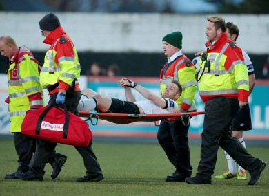 O'Donnell is stretchered off the pitch last night.