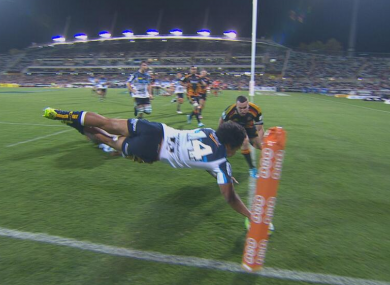 Joe Tomane dives over to score for the Brumbies.