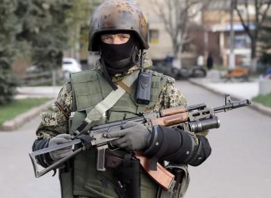 A pro-Russian gunman patrols a streets in downtown Slovyansk, eastern Ukraine.