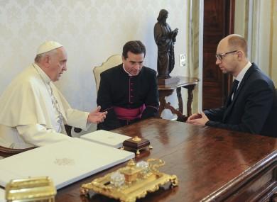 Ukrainian Prime Minister Arseny Yatsenyuk, right, and Pope Francis meet at the Vatican today.