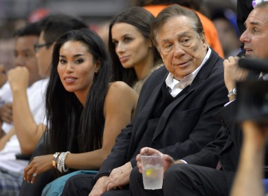 Los Angeles Clippers owner Donald Sterling, right, and V. Stiviano, left at a recent game.