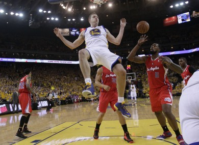 David Lee drops from the rim after dunking against the Clippers last night.
